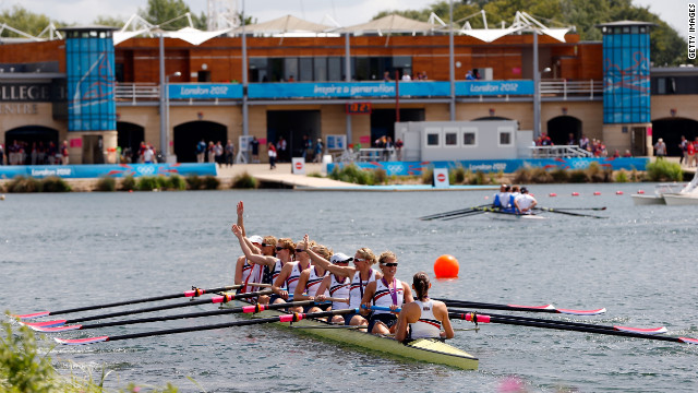 Wearing their gold medals, members of the U.S. team celebrate in their boat.