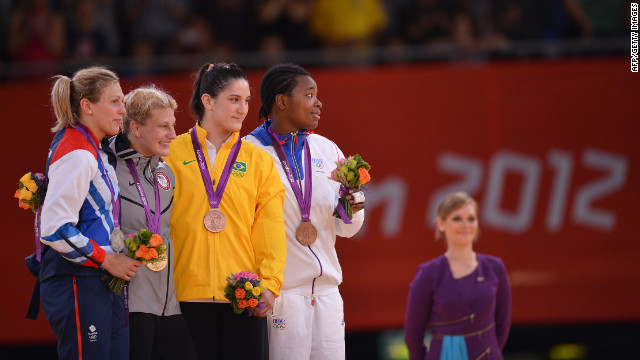 From left, Britain's silver medalist Gemma Gibbons, United States' gold medalist Kayla Harrison, Brazil's bronze medalist Mayra Aguiar, and France's bronze medalist Audrey Tcheumeo, pose on the podium after the women's judo competition.