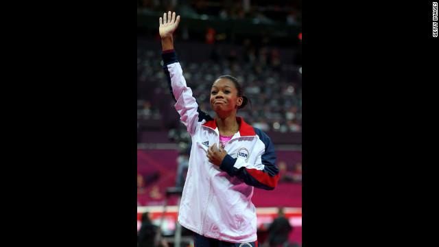 Douglas waves to the crowd after winning the gold medal.