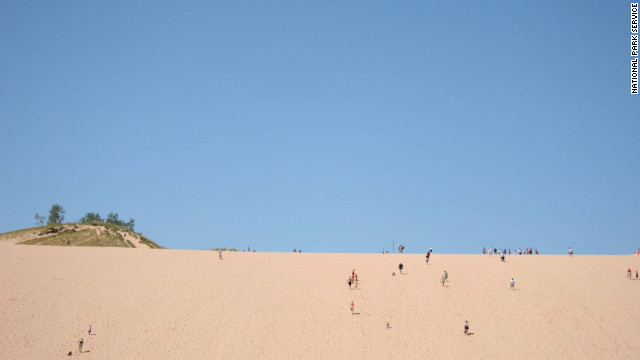 Many visitors take on the challenge of climbing to the top of the dunes at Sleeping Bear Dunes National Seashore. 