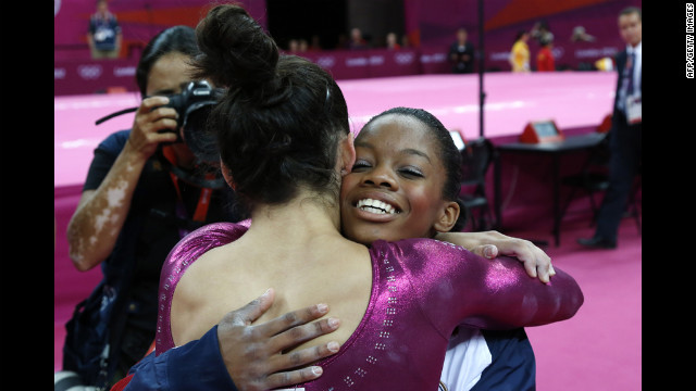 U.S. gymnast Gabby Douglas, right, embraces teammate Alexandra Raisman after winning the gymnastics women's individual all-around final.