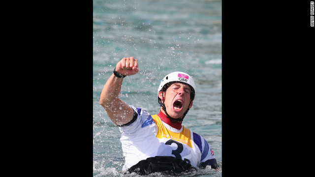 Great Britain's Etienne Stott reacts after winning gold in the men's canoe double slalom final.