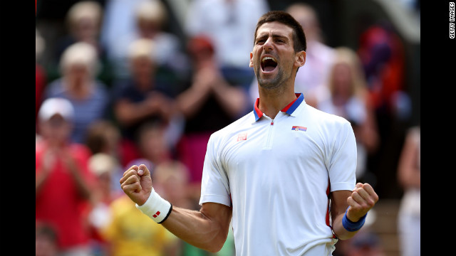 Serbia's Novak Djokovic celebrates after defeating France's Jo-Wilfried Tsonga in the men's singles tennis quarter-finals.