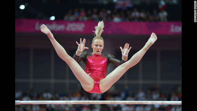 Romania's Sandra Raluca Izbasa performs on the uneven bars during the artistic gymnastics women's individual all-around final.
