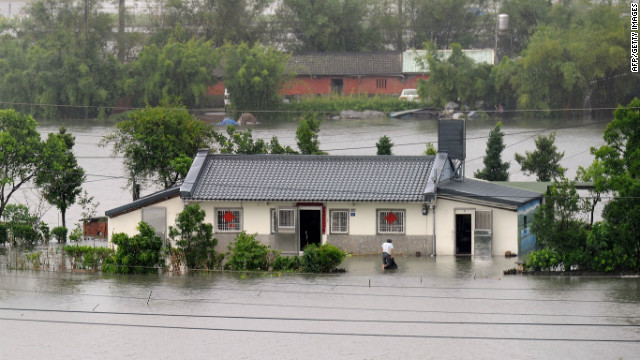 A man cleans his house in Taiwan's eastern Yilan County as Typhoon Saola approaches the island's east coast Thursday. 