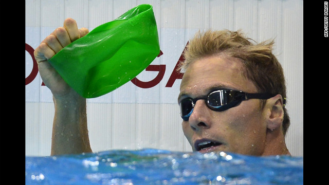 South Africa's Roland Schoeman rescues his bath toy from the bottom of the pool.