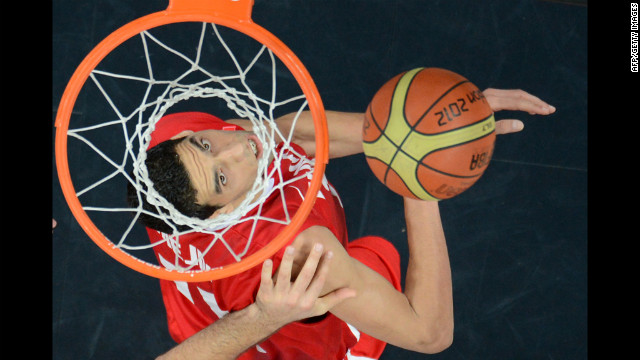 Tunisian center Salah Mejri scores during the men's preliminary round group A basketball match against Argentina.