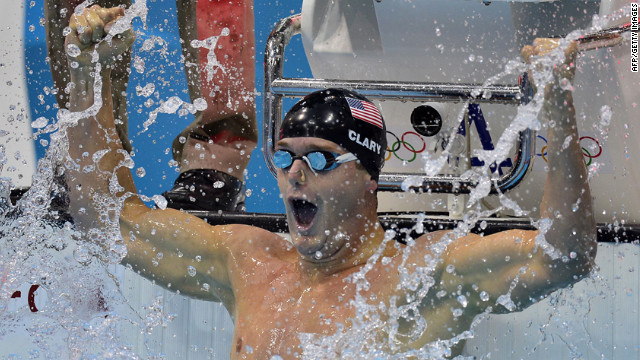 Tyler Clary celebrates winning gold in the men's 200-meter backstroke final swimming event.