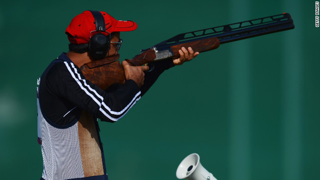 Ahmed Al Hatmi of Oman competes in the men's double trap shooting qualification round. Check out photos from Day 7 of the competition from Friday, August 3.