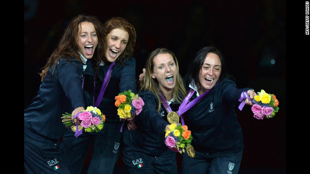 Left to right: Italy's Elisa Di Francisca, Arianna Errigo, Valentina Vezzali and Ilaria Salvatori celebrate with their gold medals on the podium of the women's foil final as part of the fencing event.