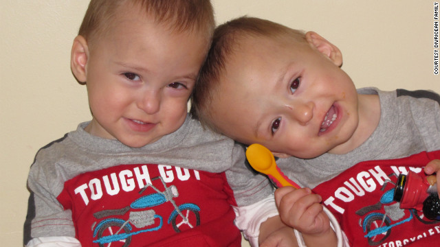 Andrew, left, and Patrick show off their tough guy status at 18 months.