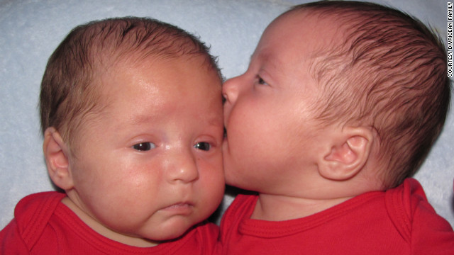 Andrew, right, gives his 3-month-old brother Patrick a kiss. 