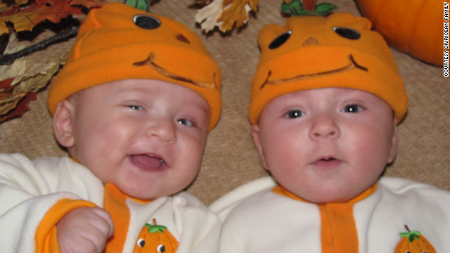 Nelly and Michael dressed their twins up as pumpkins for Halloween in 2009.