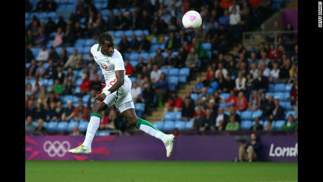 Ibrahima Balde of Senegal heads the ball during the men's football first round group D match against United Arab Emirates in Coventry, England.