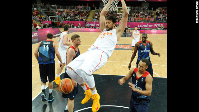 Spain's Victor Sada scores during the men's basketball preliminary round match between Spain and Britain.