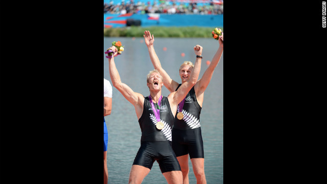 New Zealand's Eric Murray, left, and Hamish Bond celebrate with their gold medals during the ceremony for the men's pair at the Olympic rowing regatta.