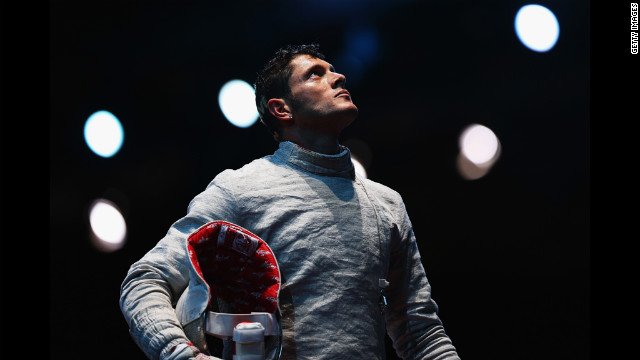 Italy's Aldo Montano awaits a decision during the men's saber team fencing quarterfinal against Aliaksandr Buikevich of Belarus.