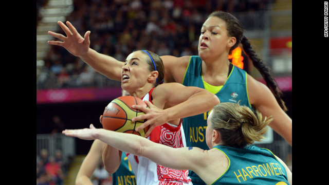 Russian guard Becky Hammon, left, vies with Australian center Elizabeth Cambage during a women's preliminary round basketball match.