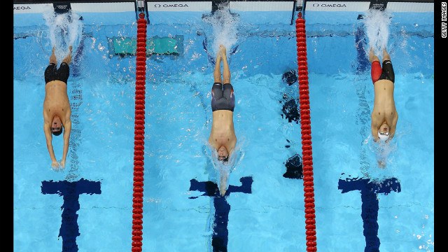 Left to right: Ryan Lochte, Tyler Clary and China's Fenglin Zhang compete in the men's 200-meter backstroke final.