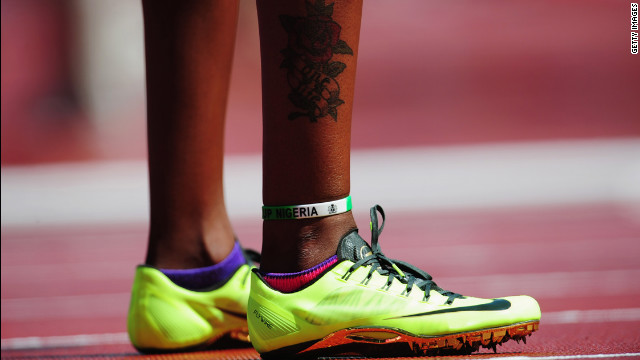 Regina George of Nigeria shows off some colorful footwear before the women's 400-meter heats.