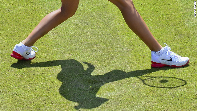 The Czech Republic's Andrea Hlavackova casts a shadow on the court as she warms up before a women's double tennis semifinal against Americans Liezel Huber and Lisa Raymond.