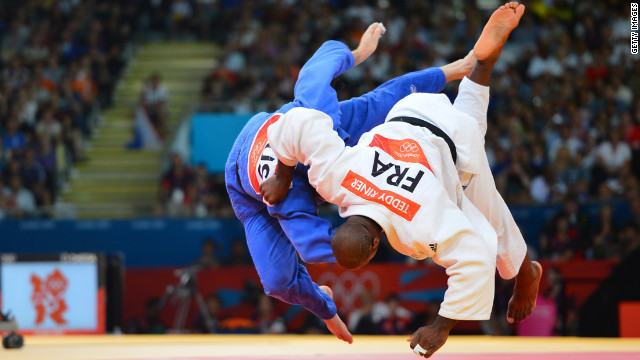 France's Teddy Riner, right, fights Russia's Alexander Mikhaylin to win the gold in the men's over 100-kilogram judo final on Friday.