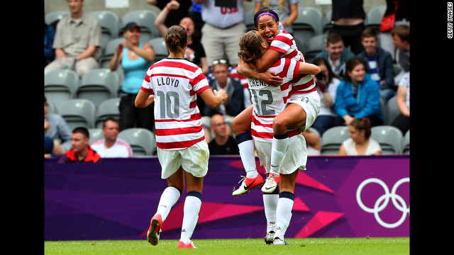 American Sydney Leroux, right, celebrates with teammates Lauren Cheney, center, and Carli Lloyd after scoring against New Zealand during the women's football quarterfinal match.