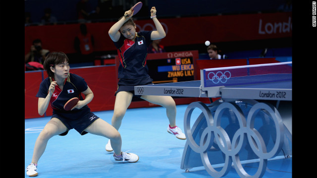 Japan's Kasumi Ishikawa, left, and Ai Fukuhara compete against a U.S. team in the women's team table-tennis action.