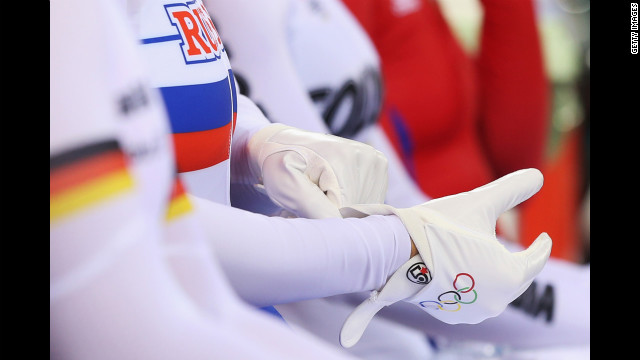 Russia's Ekaterina Gnidenko puts on her gloves as she prepares to compete in the women's cycling-track keirin qualifying event.