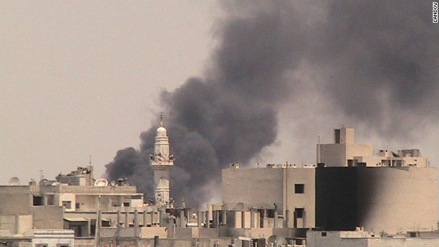 Smoke rises from Al-Safsaf in Homs on Friday, August 3. 