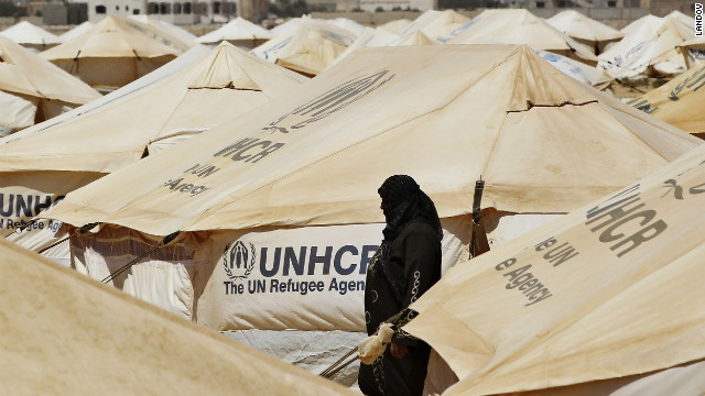 A Syrian refugee walks at the Al Zaatri refugee camp in the Jordanian city of Mafraq, near the border with Syria, on Friday, August 3.