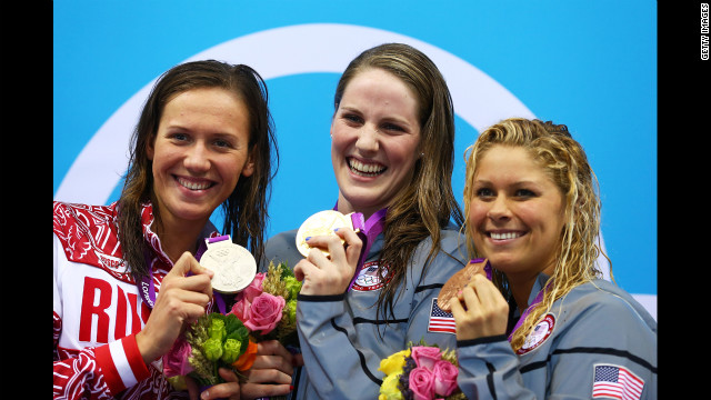 Left to right: Silver medalist Anastasia Zueva of Russia, gold medalist Missy Franklin of the United States and bronze medalist Elizabeth Beisel of the United States on the podium during the medal ceremony for the women's 200-meter backstroke final on Day 7 of the London 2012 Olympic Games.