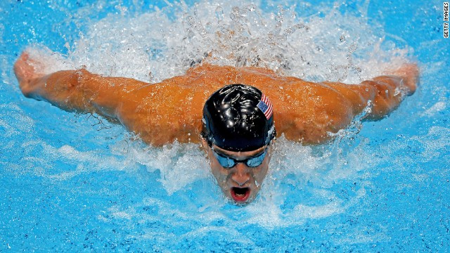Michael Phelps competes in the men's 100-meter butterfly final.