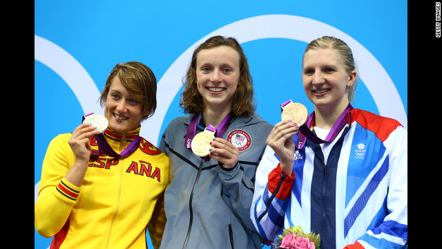 Left to right: Silver medallist Mireia Belmonte Garcia of Spain, gold medalist Katie Ledecky of the United States and bronze medalist Rebecca Adlington of Great Britain on the podium during the medal ceremony for the women's 800-meter freestyle final on day 7 of the London 2012 Olympic Games.