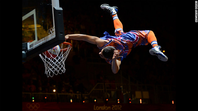 Spud Webb sneaks into Olympics, wins slam-dunk contest again.