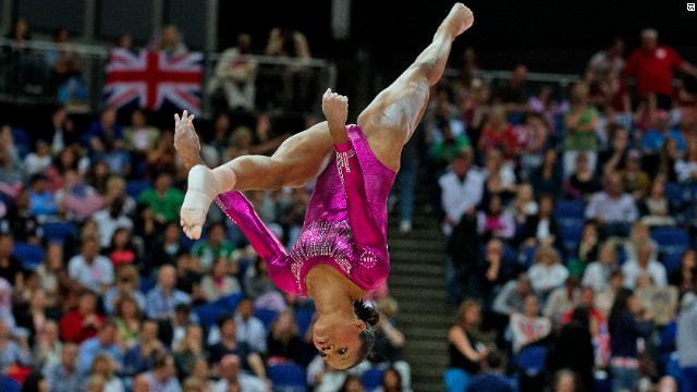 """U.S. gymnast Gabby Douglas wins gold in the women's all-around individual competition. The 16-year-old, nicknamed """"the flying squirrel"""" defeated Russia's Viktoria Komova by 0.259 marks."""