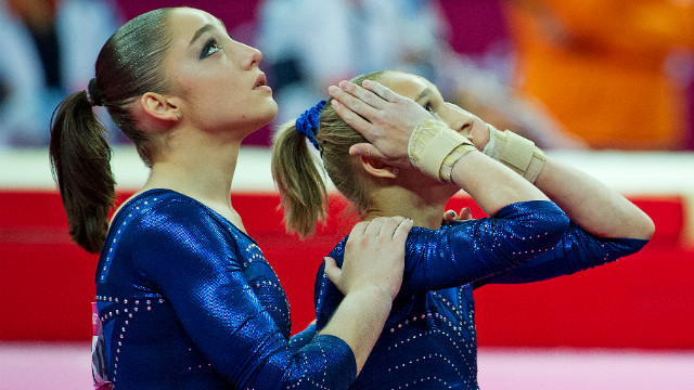 Russian pair Mustafina and Victoria Komovs were forced to settle for bronze and silver respectively after Douglas dazzled the judges.&lt;br/&gt;&lt;br/&gt;