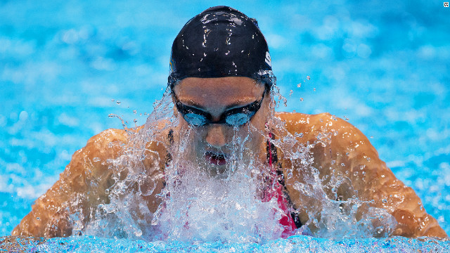 U.S. swimmer Rebecca Soni powered her way to gold in the women's 200m breaststroke after clocking a world record time of two minutes and 19.59 seconds.