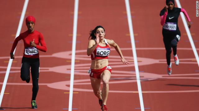 Oman's Shinoona Salah Al-Habsi, left, and Diane Borg of Malta compete in the women's 100-meter heats. Check out photos from <a href='http://www.cnn.com/2012/08/04/worldsport/gallery/olympics-day-8/index.html' target='_blank'>Day 8 of the competition </a>on Saturday, August 4.