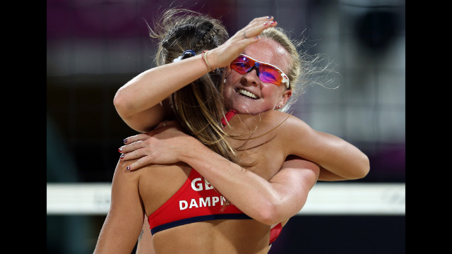 Great Britain's Zara Dampney, left, and Shauna Mullin celebrate after a point against Doris Schwaiger and Stefanie Schwaiger of Austria during the women's beach volleyball preliminary match.