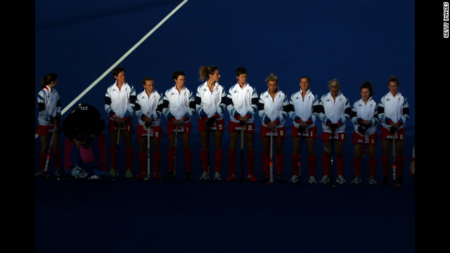 The Great Britain hockey team lines up for the national anthem ahead of their preliminary match against Belgium.