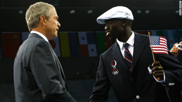 Former U.S. President George W. Bush greets Lomong on the opening day of the Beijing 2008 Olympic Games.