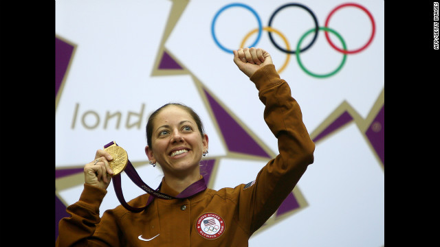 Gold medalist Jamie Lynn Gray of the United States celebrates on the podium after winning the 50-meter rifle 3 positions women's final Saturday, August 4.