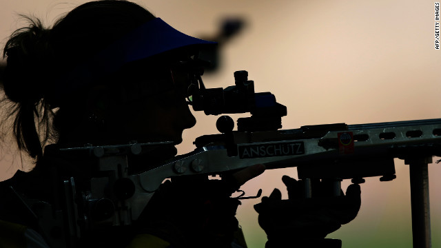 Gray aims a shot in the 50-meter rifle 3 positions women's qualification at the Royal Artillery Barracks in London.