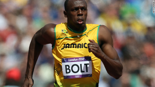 Usain Bolt sprints to victory in his 100m heat at the London Olympics to qualify for the semifinals.