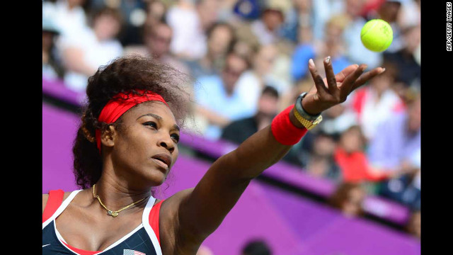 Serena Williams serves to Russia's Maria Sharapova during the women's singles tennis final.