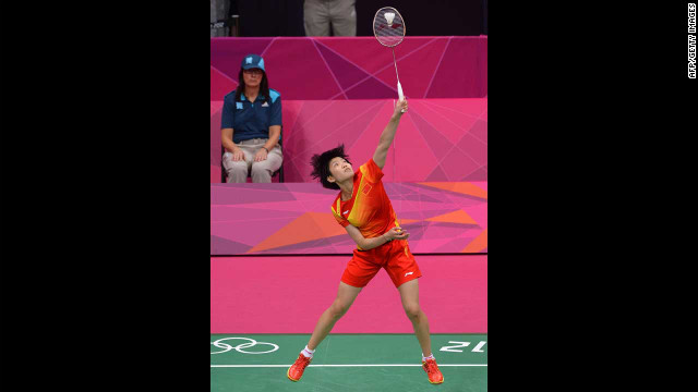 China's Wang Xin plays against India's Saina Nehwal in the bronze medal women's singles badminton match.