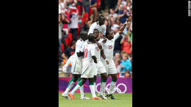 Senegal celebrates after Ibrahima Balde scored a goal during the men's football quarterfinal match against Mexico.