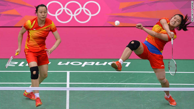 China's Zhao Yunlei, left, and Tian Qing, right, play against Mizuki Fuji and Reika Kakiiwa (not pictured) in the women's doubles badminton final match.