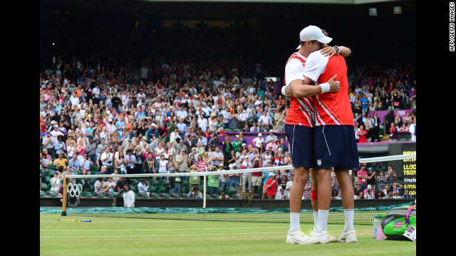 Brothers Mike Bryan, left, and Bob Bryan embrace after defeating France's Michael Llodra and Jo-Wilfried Tsonga in the men's doubles gold medal tennis match on Saturday, August 4, at Wimbledon.